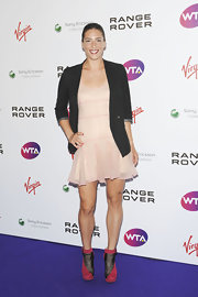 Andrea Petkovic wore a pair of hot pink and black ankle boots with her sheer pink dress and black jacket at the Pre-Wimbledon party.