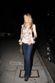 Kimberly's wide-leg jeans show a peeking pair of cheetah-printed, platform sandals.