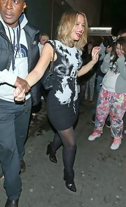 Kimberley Walsh donned a black-and-white abstract-print dress for a night out at the Whiskey Mist Club.