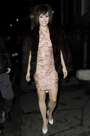 Kimberly made her way out of The Punchbowl Pub donning an interesting fur coat and what looked to be a cute floral dress. She topped her look off with a shaggy mid-length bob.