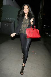 Kimora Lee Simmons sported a pair of black leggings with a sheer blouse and blazer while out in LA.