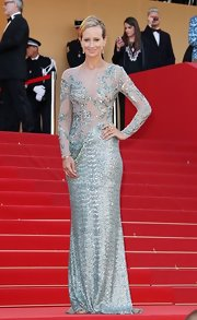 Lady Victoria Hervey attended the premiere of 'On the Road' wearing a long sleeve silver and seafoam green sequined gown featuring a sheer cutout design.