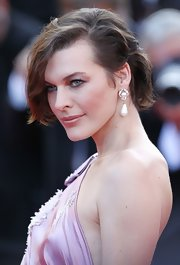 Milla Jovovich wore her undercut bob with long dramatically side-swept bangs for the 'On the Road' premiere at Cannes.