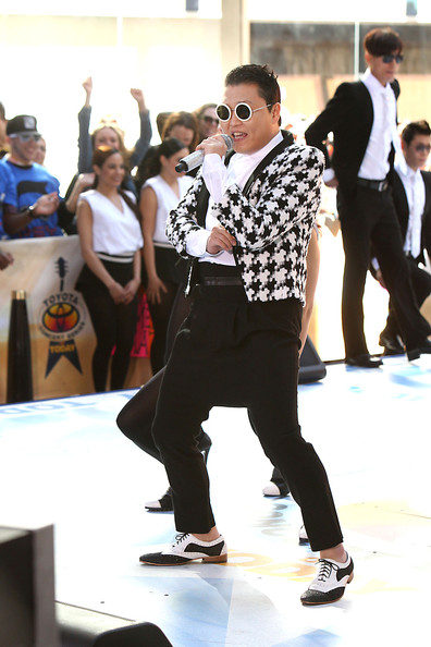 Psy performed in classic black pants paired with a quirky cardigan.