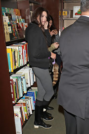 Kendall Jenner kept her look casual at her sisters' book signing in a basic black hoodie.