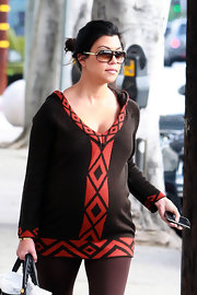 Kourtney has bohemin pergnancy style and rocks her brown shield shades with gold detail. Super Cute.
