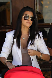 "The chic mommy sported a gold pair of ""2021"" aviator shades with dark brown lenses."