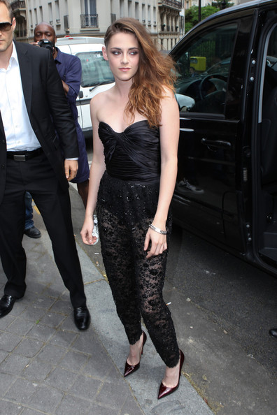 Kristen Stewart wore a strapless, black bustier top with a pair of sheer lace pants for her edgy and sexy look at the Zuhair Murad couture show in Paris.