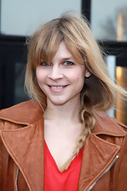 Clemence Poesy wore her hair in a loose braid swept over her shoulder while attending fashion week.