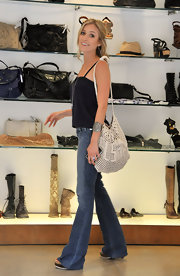 "Kristin enjoyed a day of shopping with fellow ""Hills"" star Audrina in Beverly Hills. She paired her casual denim and tank outfit with a large off-white hobo bag."