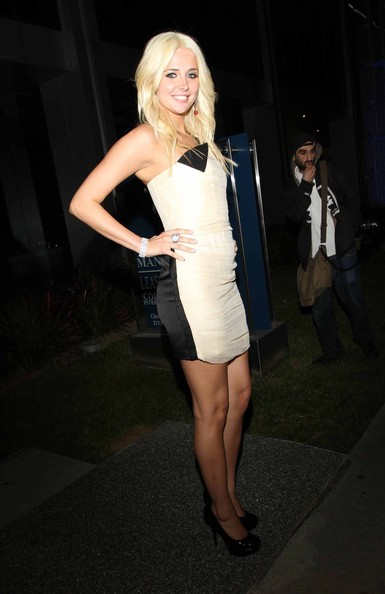 The bleach-blonde bunny posed in a two-toned mini dress and a basic pair of black patent leather platform pumps.