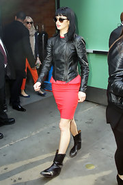 Krysten Ritter arrived for an appearance on 'Good Morning America' wearing a pair of black cowboy boots which she paired with a leather motorcycle jacket and sexy red sheath.