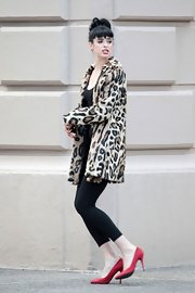 "Krysten Ritter's red pumps were the perfect contrast to her leopard-print coat on the set of ""Dont Trust the B--- in Apartment 23."""