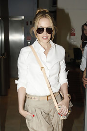 Kylie paired her messy do with dark, brown aviator shades.