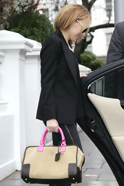 Kylie Minogue's Amazona bag injected the perfect amount of girly flair into her business attire thanks to its sweet pink handles.