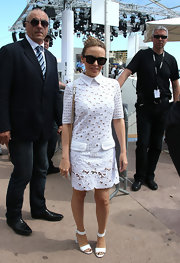 Kylie Minogue's white eyelet frock looked totally summery and light, perfect for Cannes.