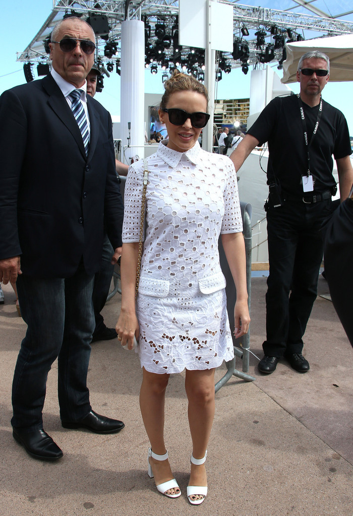 Kylie Minogue walks on the Promenade de la Croisette to have lunch with director Leos Carax (with the hat) at the Eres Palm beach of the Hotel Martinez during 66th Cannes Film Festival 2013. Carax directed Kylie in 'Holy Motors', presented in Cannes last year.