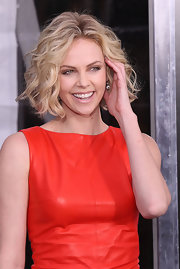 Charlize Theron wore a pair of classic and antique cushion-cut diamond pendant earrings at the premiere of 'Young Adult.'