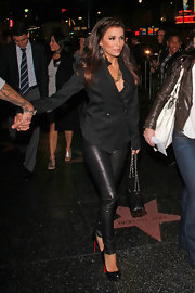 Eva Longoria tamed down her sexy leather pants with a sophisticated blazer.