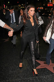 Eva Longoria chose a rocker chic premiere look in tight leather pants and towering pumps.