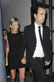 Jen donned a chic little black dress while out with beau Justin Theroux in London.