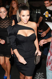 Kim looked gorgeous with a braided high bun and peachy makeup.