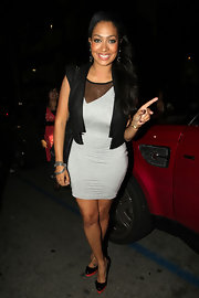 La La Anthony enjoyed a night out at Katsuya wearing a black vest over a gray mini dress.