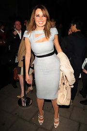 Carol showed off her tiny waist in a grey pencil dress, complete with cut outs at the bodice.
