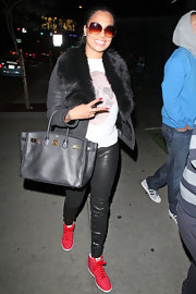 La La Anthony finished off her sporty-glam ensemble with a chic black Birkin during a dinner out at Boa Steakhouse.