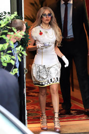 Lady Gaga was chic while out and about London. She opted for sky-high pink pumps complete with strappy detailing.