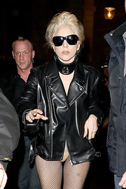 Lady Gaga donned black framed sunglasses with her pantless ensemble.