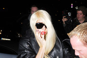 Lady Gaga leaves her London hotel to head out for fish and chips at Sea Shell restaurant. Gaga, wearing a long leather coat, reportedly changed her mind and went to her tour bus where she had the fish and chips delivered.
