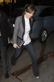 Olivia Wilde went for an equestrian look in a gray tweed blazer with black contrasting lapels.
