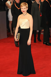 Michelle Williams wore a black-and-white evening dress with a dainty bowed waist for the BAFTAs.