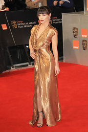 Christina Ricci was the golden girl on the BAFTA red carpet in this iridescent gown.