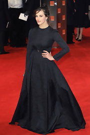 Even though Jessica Brown-Findlay was all covered up in this long-sleeve black evening gown she was still radiant.