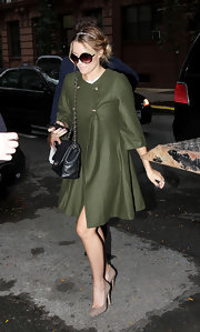 Lauren Conrad paired a retro inspired olive pea coat with suede taupe pumps.