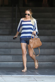 Lauren Conrad was spotted in cute cut-off shorts a striped shirt and a tan shoulder bag.