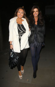 Lauren goes bright white in a warm fur coat while out in London with Janice Dickinson.