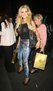 Nicola McLean attended a party at 45 Park Lane Hotel wearing sky-high pumps.