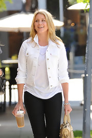 Lo Bosworth embraces the denim trend, but puts her own twist on it by donning a white denim jacket.