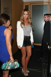 Lauren Pope chose black leather short shorts for her look at Nobu.