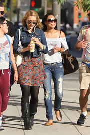 Dianna wears a classic cropped denim jacket with a tiered floral dress on the set of 'Glee'.
