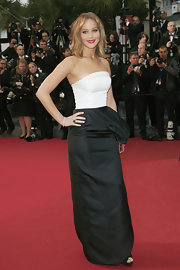 Jennifer opted for a black and white structured piece that featured an asymmetrical side ruffle.