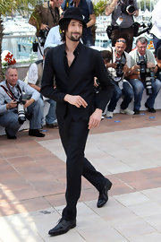 Adrien wears sleek black slacks with his dapper ensemble for the Cannes Film Festival.