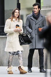 "Leighton Meester opts for comfort while filming ""Gossip Girl"" in cozy sheepskin boots."