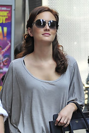 Leighton stepped out in a pair of rimless round shades with crystal-embellishments.