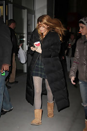 Blake Lively fought the icy NYC temperatures in a long black down coat and sheepskin boots.