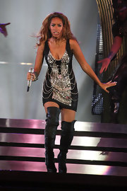 Leona rocked out on stage in crystal-studded boots and a chain-embellished mini dress.
