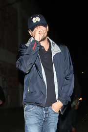 Leonardo DiCaprio went clubbing wearing a casual blue zip-up jacket, a polo shirt, and jeans.